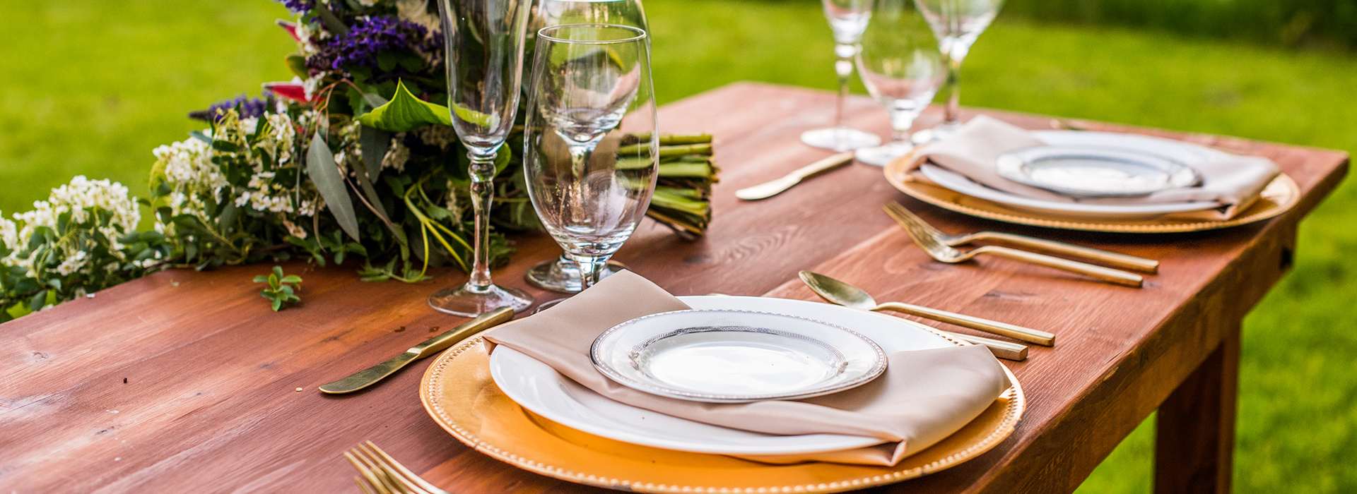 An outdoor event set by Event Essentials in shades of taupe and gold.